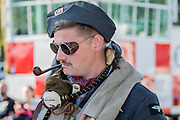 Re-enactors in vintage Air Force uniforms enjoy a break and an ice cream on an extremely hot day - Duxford Battle of Britain Air Show at the Imperial War Museum. Also commemorating the 50th anniversary of the 1969 Battle of Britain film. It runs on Saturday 21 & Sunday 22 September 2019