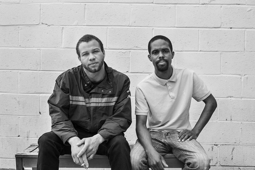 Fairfax, Virginia. April 2nd 2019 - Ceejay on the left and John on the right sit outside the lamb center for a smoke.