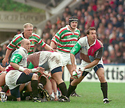 1997 Heineken European Cup, Stoop 18-4-98, Chris Sheasby, distributes the ball from the ruck, Quins Keith Wood [left ] Tigers's Neil Back and right Graham Rowntree,  [Mandatory Credit: Peter Spurrier/Intersport Images].