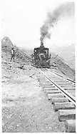 """RGS class 60 locomotive with first train through the just-opened Ames Slide.<br /> RGS  Ames, CO  6/1930<br /> In book """"Rio Grande Southern, The: An Ultimate Pictorial Study"""" page 97<br /> See RD155-077 for enlargement.<br /> Also in """"RGS Story Vol. III"""", p.68 and """"RGS Story Vol. X"""", p. 244."""