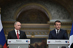 May 29, 2017 - Versailles, FRANCE - French President Emmanuel Macron, right, and his Russian counterpart Vladimir Putin hold a joint press conference at the Palace of Versailles as they meet for talks before the opening of an exhibition marking 300 years of diplomatic ties between the two countries, in Versailles, near Paris, France, Monday, May 29, 2017. Flexing his diplomatic muscles, Macron said he had ''extremely frank, direct'' talks with Russian President Vladimir Putin on Monday, pushing for cooperation on Syria and against the Islamic State group but also launching an extraordinary attack on two Russian media outlets he accused of spreading ''lying propaganda. (Credit Image: © Prensa Internacional via ZUMA Wire)