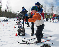 Kyle Gandini of Gilford is focused on the target as he fires a paintball at the target during Gilford Nordic's annual Paintball Biathlon event on Sunday afternoon.  (Karen Bobotas/for the Laconia Daily Sun)