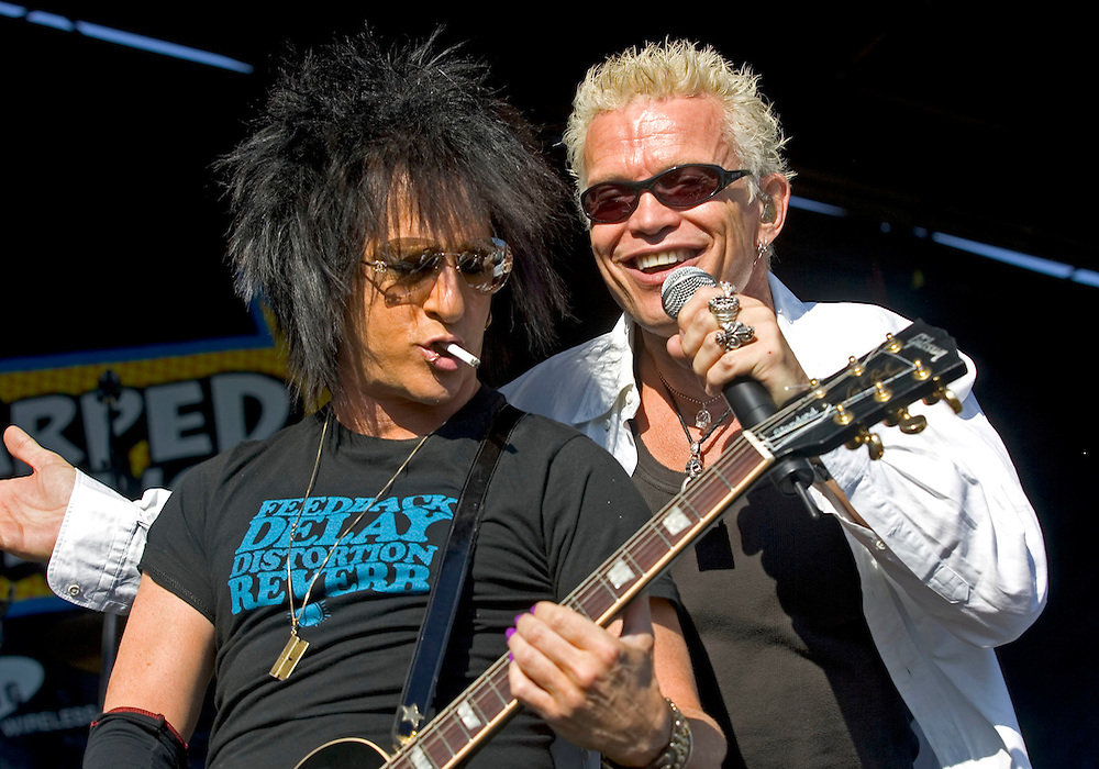 Billy Idol and his lead guitarist Steve Stevenson rock the crowd at the warped tour as it makes it's annual stop at the Utah State Fair Park in Salt Lake City, Utah Saturday July 16, 2005.  August Miller/ Deseret Morning News