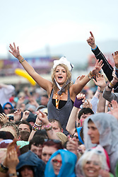 Fans watch Slash featuring Myles Kennedy play the main stage..T in the Park on Saturday 9th July 2011. T in the Park 2011 music festival takes place from 7-10th July 2011 in Balado, Fife, Scotland..©Pic : Michael Schofield.