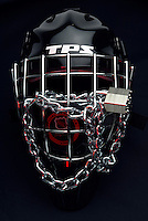 Photo Illustration of NHL ice hockey TPS goalie mask and puck locked up with chains. The NHL National Hockey League and NHLPA NHL Players Association undergoing talks of a new CBA labor agreement.