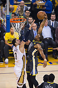 Golden State Warriors forward Andre Iguodala (9) dunks the ball against the New Orleans Pelicans at Oracle Arena during Game 2 of the Western Semifinals in Oakland, California, on May 1, 2018. (Stan Olszewski/Special to S.F. Examiner)