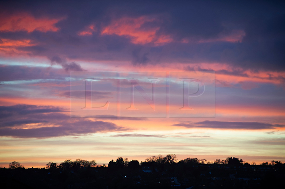 © Licensed to London News Pictures 03/02/2021.        Bromley, UK. Dark rain clouds over the London Borough of Bromley in South East London this evening as the sun sets on another wet and cold day. Photo credit:Grant Falvey/LNP