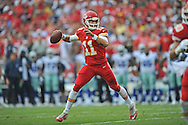KANSAS CITY, MO - SEPTEMBER 15:  Quarterback Alex Smith #11 of the Kansas City Chiefs throws a pass against the Dallas Cowboys during the first half on September 15, 2013 at Arrowhead Stadium in Kansas City, Missouri.  (Photo by Peter G. Aiken/Getty Images) *** Local Caption *** Alex Smith