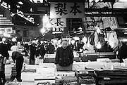 In the Island country of JAPAN, fish and seafood are the central focus of their culinary routine. The Tsukiji  Fish Markets in TOKYO process around 2,700 tons of fish a day handling more than 400 different types of seafood. The bustling marketplace comes to life in the early hours of the morning when the fish is inspected before the auctions start at around 5.30 a.m. Once bought the seafood is taken by the wholesalers back to their stalls in the markets, as well as heading off to restaurants and retailers .Almost all the fish eaten in TOKYO come from these markets. Plans to relocate the markets by 2012 are under way, a move prompted by the ageing buildings of the Tsukiji markets and the larger area of the new site at Toyosu.<br /> <br /> PIXS TAKEN......021221 (21ST DECEMBER 2002)<br /> pic shows..general scenes in and around the markets.