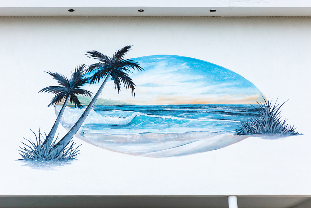 https://Duncan.co/painting-of-beach-on-motel-wall