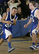 Monticello's Anthony Gray (23) and Jesse Kapito (15) celebrate after their team defeated Wallkill in a Section 9 Class A tournament game in Wallkill on Monday, Feb. 28, 2011.