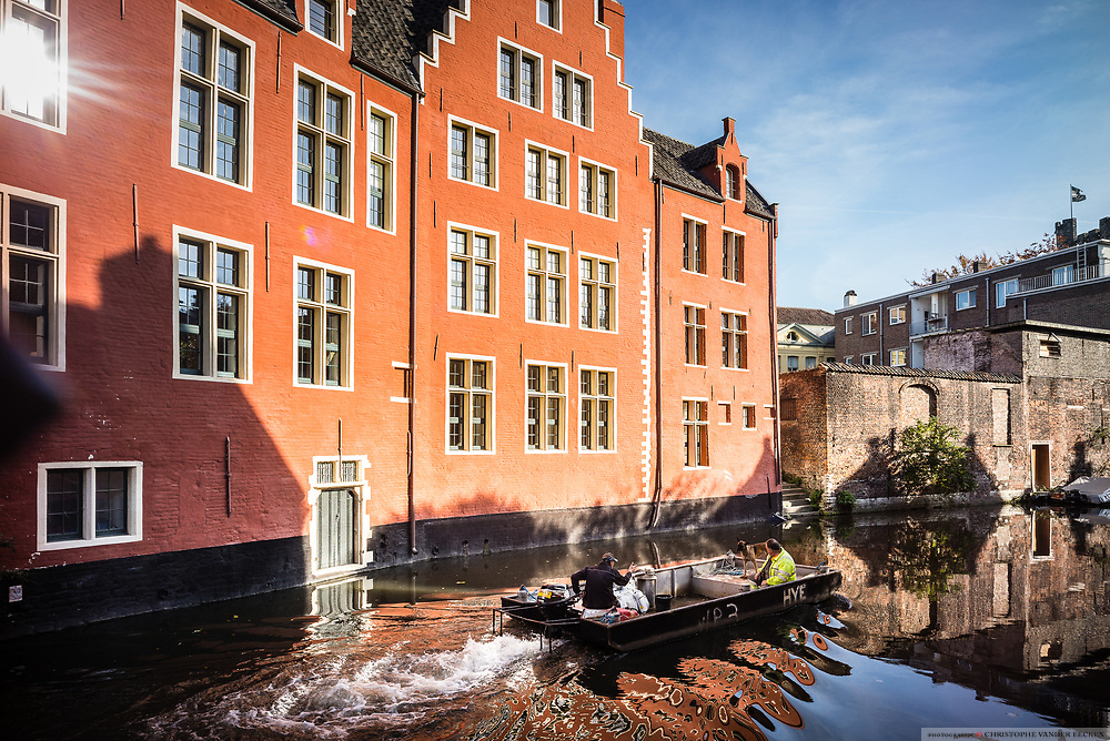 Medieval red house along the canal belongs to European Parliamentairy Guy Verhofstadt situated in the citycentre, ghent, Belgium, 26.10.2015