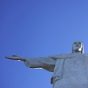 The iconic Cristo Redentor, Christ the Redeemer statue sits atop the mountain Corcovado. The Christ statue was voted one of the seven wonders of the modern world in 2007. It was designed by Brazilian Heitor de Silva Costa and was inaugurated in 1931 having taken years to assemble. Rio de Janeiro, Brazil. 21st July 2010. Photo Tim Clayton..