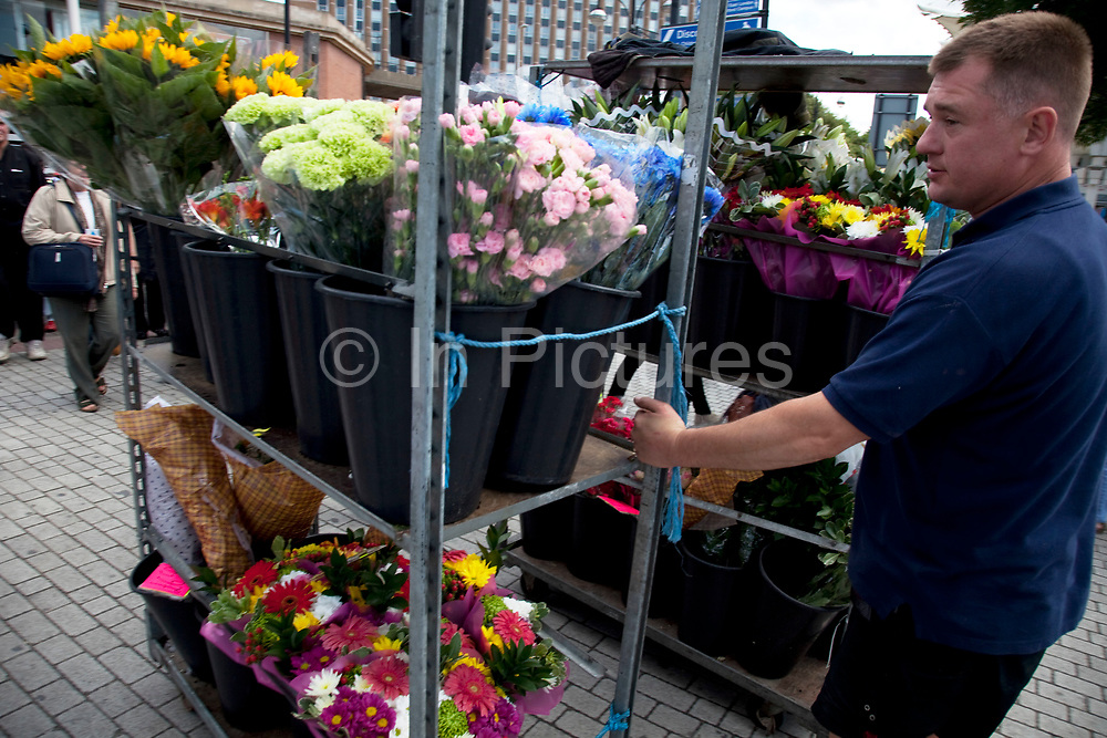 Flower seller pulling his flowers to his stall in Stratford in East London. This is a relatively poor area of London, but in recent years has seen much regeneration, the construction of a major transport hub and various shopping complexes. Stratford is adjacent to the London Olympic Park and is currently experiencing regeneration and expansion linked to the 2012 Summer Olympics. (Photo by Mike Kemp/For The Washington Post)