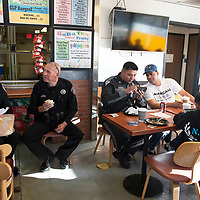Officers from New Mexico State Police, Gallup Police Department and McKinley County Sheriff's Office attend Coffee with a Cop Friday morning at Kool Beans Coffee Shop in Gallup hosted by the New Mexico State Police.