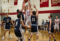 Laconia's Ryan Paiva goes up for a shot with pressure from Andrew Cavanaugh and Shawn Dekorne during Friday nights matchup with St Thomas Aquinas.  (Karen Bobotas/for the Laconia Daily Sun)