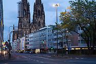 curfew from 9 pm during corona pandemic lockdown on May 5th. 2021. The deserted Komoeden street, the cathedral, Cologne, Germany.<br /> <br /> Ausgangssperre ab 21 Uhr waehrend des Corona Lockdowns am 5. Mai 2021. Die menschenleere Komoedienstrasse, der Dom, Koeln, Deutschland.