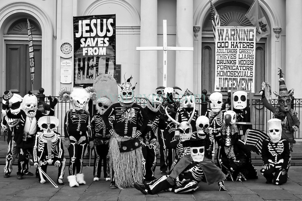 17 Feb 2015. New Orleans, Louisiana.<br /> Mardi Gras Day. Walking with Skeletons. <br /> The Skeleton Krewe discovers Christian Fundamentalists beat them to Jackson Square. The Skeleton Krewe meets before dawn beside a cemetery in Uptown New Orleans. They then walk several miles Along Saint Charles Avenue to the French Quarter to celebrate Mardi Gras Day.<br /> Photo; Charlie Varley/varleypix.com