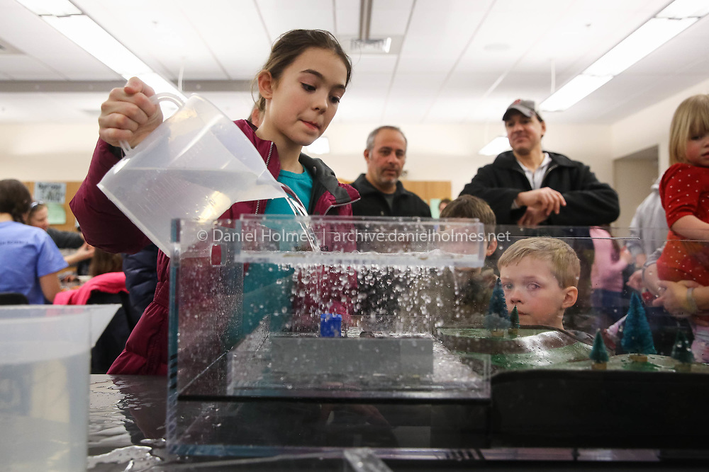 (3/16/17, FRANKLIN, MA) Bella Pelaggi, 12 , of Franklin, pours water to simulate water runoff from a parking lot during Science Night  at Franklin High School on Thursday. [Daily News and Wicked Local Photo/Dan Holmes]