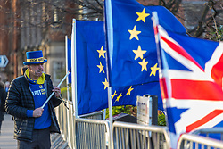 Well known anti-Brexit campaigner and leader of SODEM (Stand of Defiance European Movement) Steve Bray places EU and British Union Flags on the barriers surrounding College Green opposite the Houses of Parliament. College Green is used by all the major news broadcasters who want the backdrop of Parliament in their pictures. LONDON, September 07 2018.