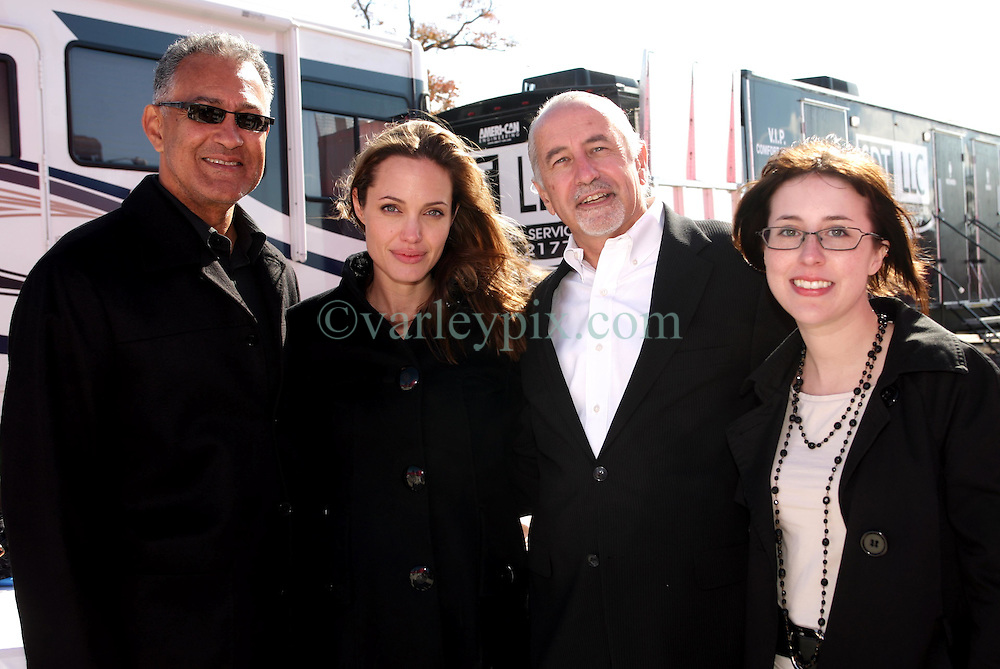 Dec 03 2007. New Orleans, Louisiana. Lower 9th Ward.<br /> Brad Pitt revisits the Lower 9th ward, devastated by Hurricane Katrina to present 'Make it Right' where architects' designs are unveiled to the public. Angelina Jolie with winning design Architects, L/R Gerald Billes, (Angelina),  Richard Kravet and Erin Porter of Billes Architecture with a pink background for the pink project.<br /> Photo credit; Charlie Varley.