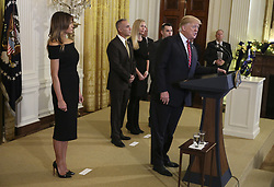 President Donald Trump speaks during a Hanukkah reception in the East Room of the White House on December 6, 2018 in Washington, DC. With Trump, first lady Melania Trump, left, and Andy Pollack, center, Julie Phillips and Hunter Pollack. Andy's 18-year-old daughter Meadow Pollack was killed in the Stoneman Douglas High School shooting on February 14, 2018. (Photo by Oliver Contreras/SIPA USA)