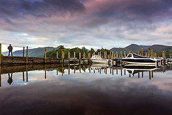 © Licensed to London News Pictures. 03/08/2020. Keswick UK. The mountains that surround Derwentwater in Keswick reflect into the calm waters at dawn this morning in Cumbria. Photo credit: Andrew McCaren/LNP