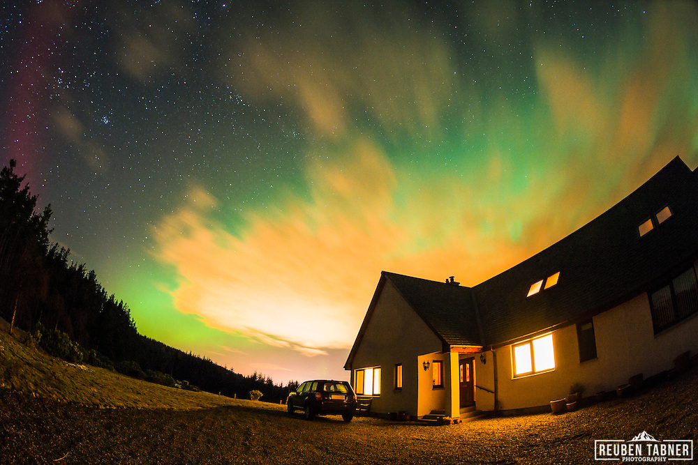 The Aurora Borealis (Northern Lights) light up the sky above Inverness in the Highlands of Scotland.
