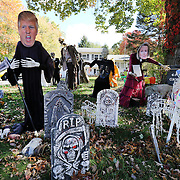 CLINTON, CONNECTICUT- OCTOBER 26:  Donald Trump depicted as the Grim Reaper and Hilary Clinton make up a Halloween scene combining the season and the upcoming presidential election in the garden of a home in the coastal town of Clinton, Connecticut on October 26, 2016 (Photo by Tim Clayton/Corbis via Getty Images)