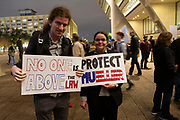Sam Katz (left) and Alyssa Gargurolia attend the Red Line protest against President Trump's firing of Attorney General Jeff Sessions and removing Deputy Attorney General Rod Rosenstein oversight of Special Counsel Robert Mueller's investigation of the Trump administration.