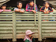 16 JUNE 2014 - POIPET, CAMBODIA: Cambodian migrants in a Cambodian army truck waiting to go home after they returned to Cambodia from Thailand. More than 150,000 Cambodian migrant workers and their families have left Thailand since June 12. The exodus started when rumors circulated in the Cambodian migrant community that the Thai junta was going to crack down on undocumented workers. About 40,000 Cambodians were expected to return to Cambodia today. The mass exodus has stressed resources on both sides of the Thai/Cambodian border. The Cambodian town of Poipet has been over run with returning migrants. On the Thai side, in Aranyaprathet, the bus and train station has been flooded with Cambodians taking all of their possessions back to Cambodia.   PHOTO BY JACK KURTZ