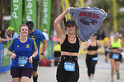 Amy Farber of Parkland, Fla., an alum of Marjory Stoneman Douglas High School, holds a T-shirt from the school at the finish line of the Publix A1A Marathon in Fort Lauderdale, FL, USA on Sunday, February 18, 2018. Photo by Joe Cavaretta/Sun Sentinel/TNS/ABACAPRESS.COM