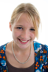 Portrait of a teenage girl in the studio smiling,