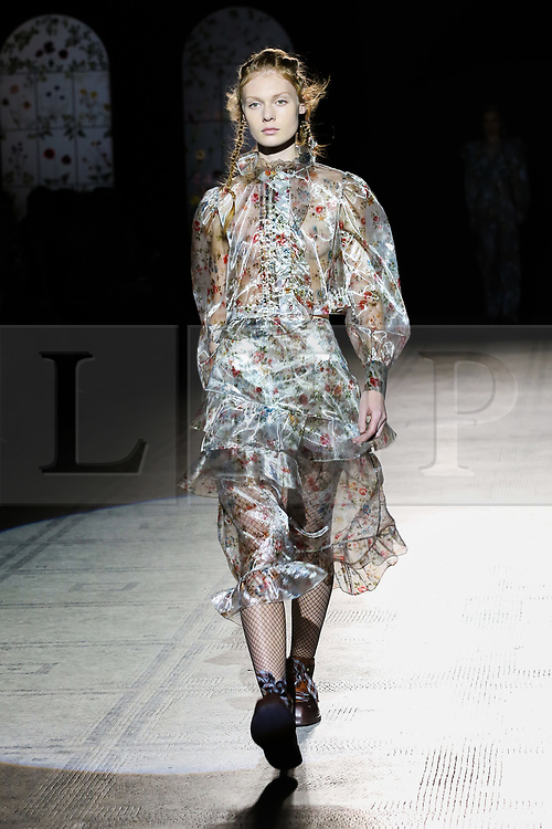 """© Licensed to London News Pictures. 21/06/2019. London, UK. A model presents Preen by Thornton Bregazzi at the """"Fashion in Motion"""" at V&A Museum, wearing colourful pieces from the designers' current collection and their archive themed around floral motifs and pagan references which coincides with the Summer Solstice and its celebration of light, nature and growth. Photo credit: Dinendra Haria/LNP"""