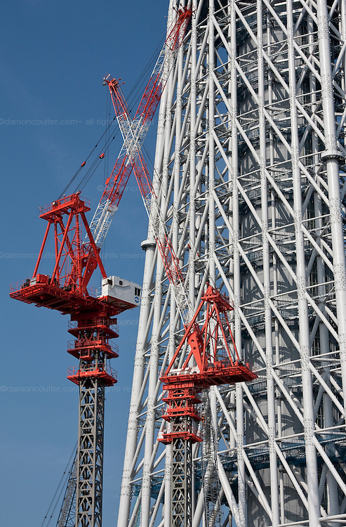 Tokyo Sky Tree under construction. In this image this new telecommunication tower stands at 398 metres and when finished will measure 634 metres from top to bottom making it the tallest structure in East Asia. Oshiage, Tokyo, Japan June 21st 2010
