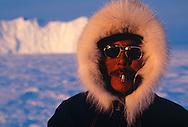 Inuit hunter Thomas Nutararearq in wolf fur trimmed parka, Baffin Island, Nunavut, Canada, Arctic