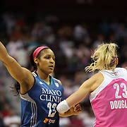 Maya Moore, (left), Minnesota Lynx and Katie Douglas, Connecticut Sun, in action during the Connecticut Sun Vs Minnesota Lynx, WNBA regular season game at Mohegan Sun Arena, Uncasville, Connecticut, USA. 27th July 2014. Photo Tim Clayton