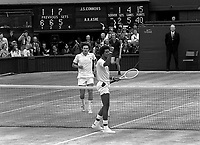 Tennis - 1975 Wimbledon Championships - The Mens Singles Final.<br /> <br /> Arthur Ashe celebrates victory over Jim Connors at the net on Centre Court. <br /> <br />  Credit: Colorsport / Mike Wall.