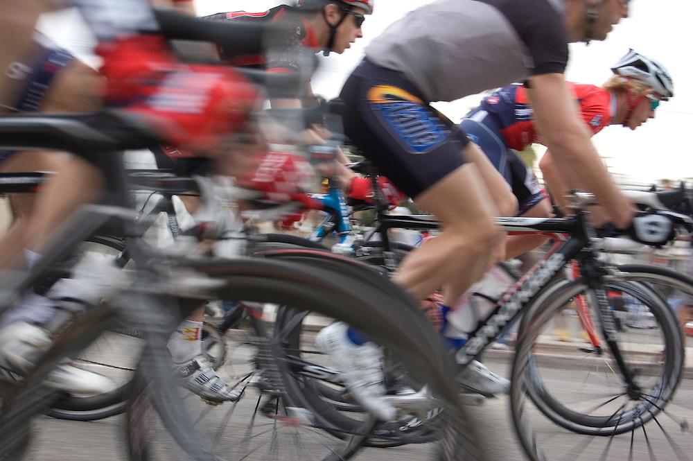 Speeding bicycle racers during the 2010 UA Criterium on the University of Arizona's Tucson campus. Bike-tography by Martha Retallick.