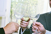 Three wine glasses, three people, a million reasons for a toast.