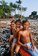 Children on outrigger canoe, Milolii, Island of Hawaii