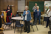 DURANT, OKLAHOMA - MARCH 24:  Locals stand for the Pledge of Allegiance before lunch at the Bryan County Retired Senior Volunteer Program in Durant, Oklahoma on March 24, 2017. (Photo by Cooper Neill for The Washington Post)