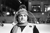 1975, Manhattan, New York, New York, USA --- Comedian John Belushi, in a bumble bee costume, skates at the Rockefeller Center Ice Rink for a skit on Saturday Night Live. --- Image by © Owen Franken