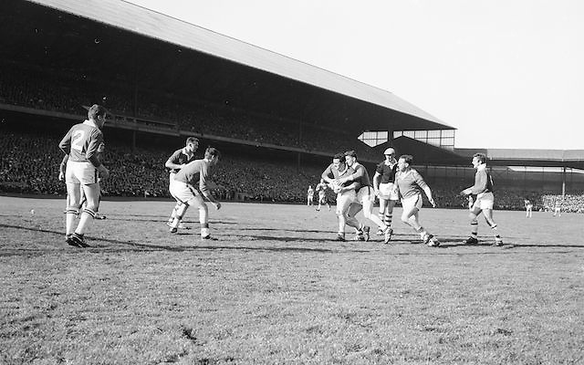 Meath player tackles Cork player for ball during the All Ireland Senior Gaelic Football Final Cork v. Meath in Croke Park on the 24th September 1967.