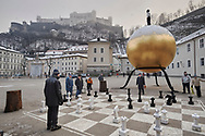 Unreliable Sightings - Saltzburg is a selective colour photography series by photographer Paul Williams  of men playing at a giant chess board taken in the snow in a Saltzburg square in 2008 .