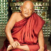 Monk sitting at one of Yangon's pagodas