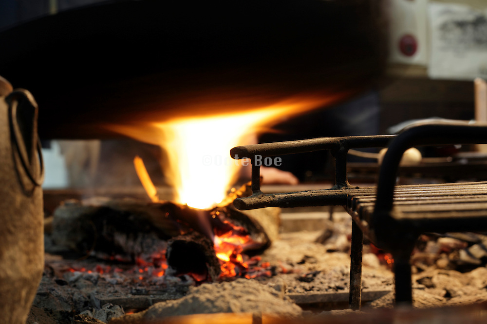 wood fire under old iron pot