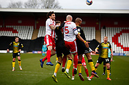 Stevenage FC and Barrow all trying to header the ball at the goal mouth during the EFL Sky Bet League 2 match between Stevenage and Barrow at the Lamex Stadium, Stevenage, England on 27 March 2021.