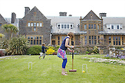Playing croquet in the garden at Pickwell Manor. From left to right: Milly-grace (8), Liza Baker (9). Pickwell Manor, Georgeham, North Devon, UK.<br /> CREDIT: Vanessa Berberian for The Wall Street Journal<br /> HOUSESHARE