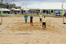 © Licensed to London News Pictures. 05/04/2015. Brighton, UK. Friends playing Volleyball on the Beach in Brighton on Easter Sunday, Today, April 5th 2015. Photo credit : Hugo Michiels/LNP